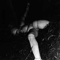 Hans Bellmer. La Poupée (Doll Abandoned in Hayloft), 1938. Vintage gelatin silver print, 14.2×14.5 cm. Ubu Gallery, New York, and Galerie Berinson, Berlin